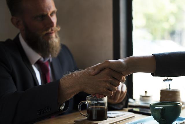 spanish business culture meeting handshake